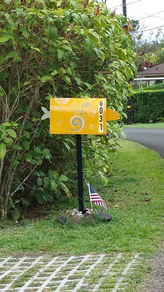 mailbox decorated with tin fish head and tail