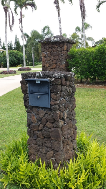 Mailbox mounted in stone.