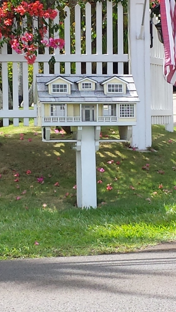 model of house as mailbox