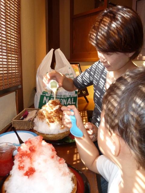 Enjoying kaki gori (Japanese shave ice) on a hot and humid day