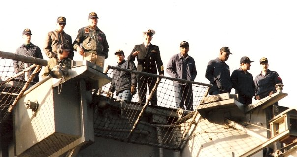 Brett up on deck, returning home after being deployed for six months in support of Operation Desert Storm in 1991 (the other sailors are in work uniforms; they will be staying aboard ship).