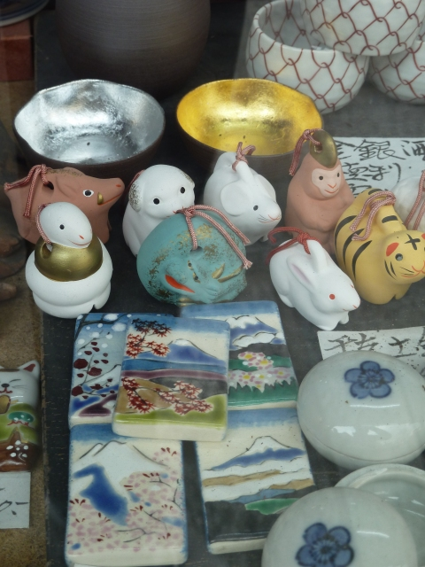 Traditional crafts (mingei) including clay bells representing the animals of the zodiac
