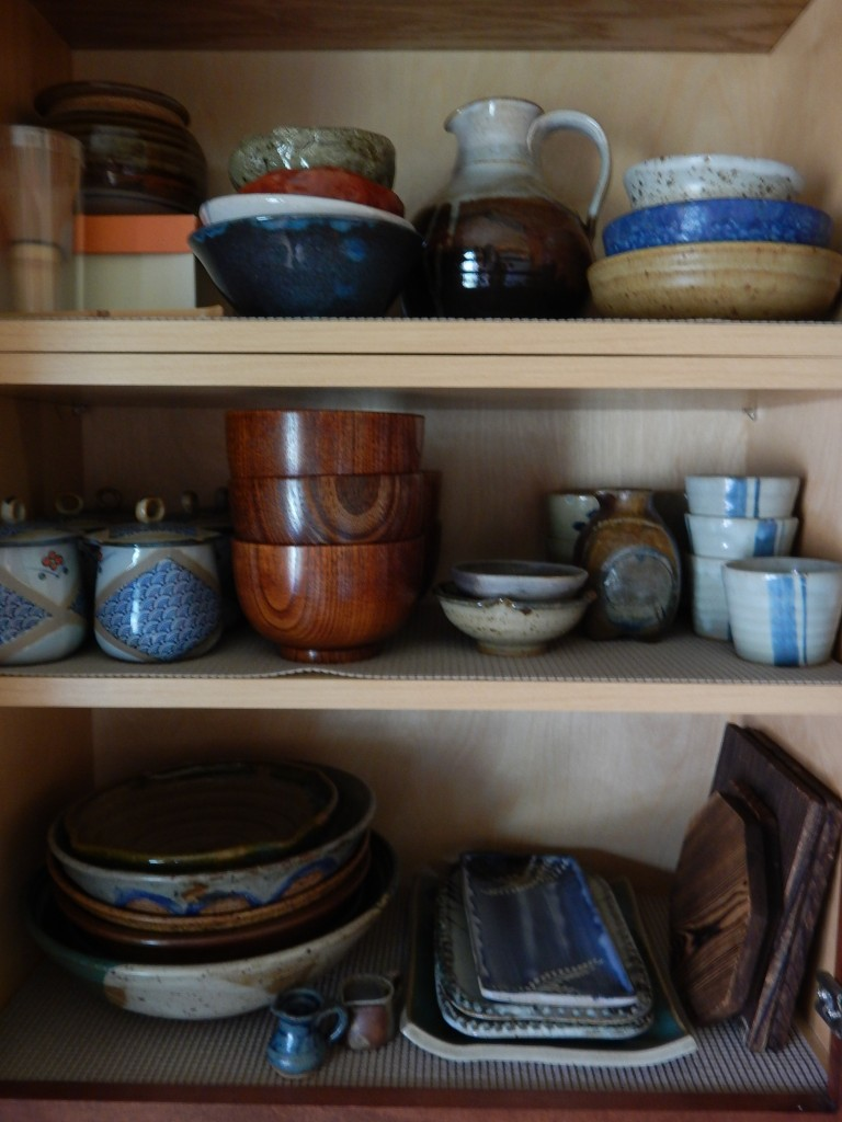 The main pottery cabinet (which also holds my lacquered wood soup bowls and wood trivets)