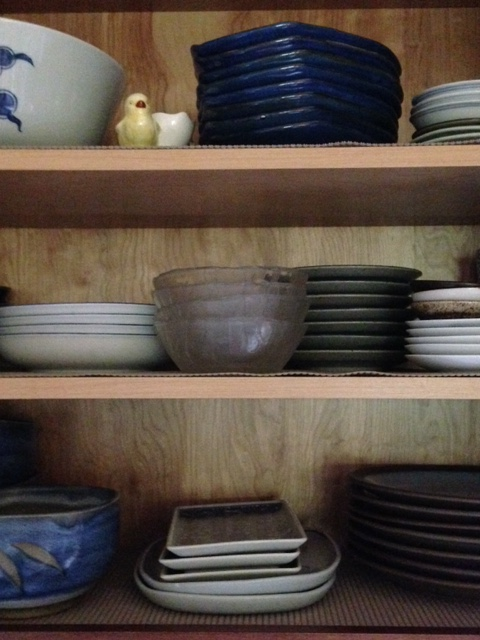 """Some of the other pottery cabinet with our """"everyday"""" dishes. There's a few pieces of Chinese porcelain in there as well, and my Japanese glass salad bowls."""