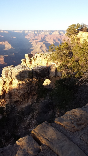 Limestone in upper Grand Canyon with water worn tunnel through it.