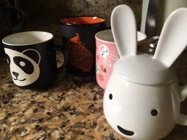 The girls' childhood cups (and WenYu's treasured Good Mythical Morning mug)