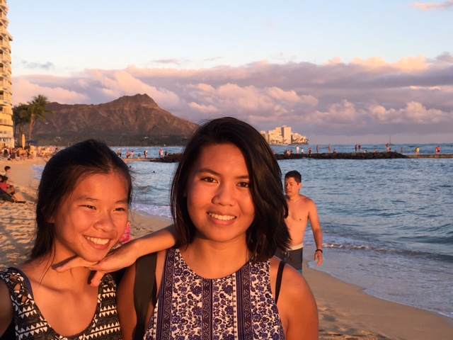 Ou intrepid shoppers relaxing on Waikiki Beach at sundown