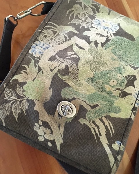 The faded front of my beloved purse