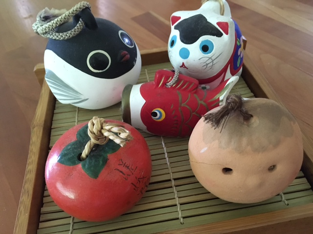 A fugu, Inu Hariko, koinobori, persimmon and clay face from Mashiko.