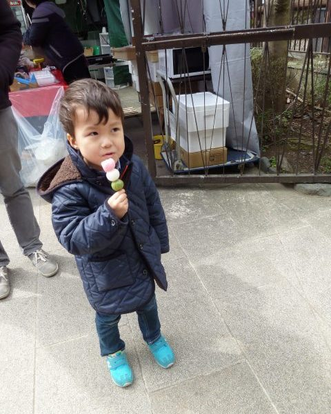 At Saga-Arashiyama station, our grandson enjoys a traditional Japanese treat, mochi dango. The balls made from pounded sweet rice