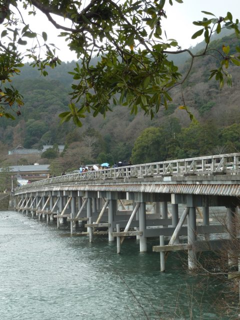 The Togetsukyou Bridge crosses the K River, with Arashiyama in the back.
