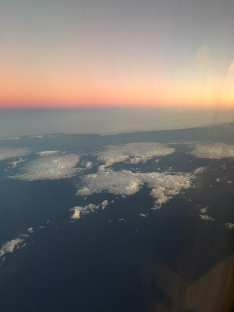 The sunset out over Hawai'i from the plane window