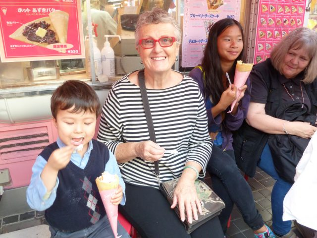 Sharing a crepe with my grandson at Harajuku