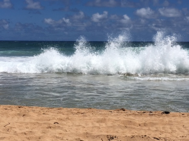 The undertow going out meets a wave coming in