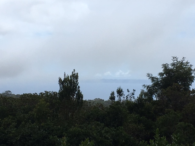 "Taken at the xx viewpoint, the gray smudge on the horizon is the ""Forbidden Island,"" Niihau, being overtaken by rain clouds."