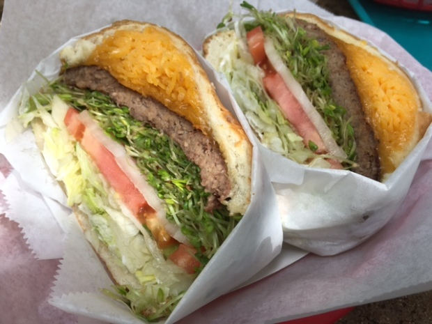 "An ""Old Fashioned,"" with cheese, lettuce, tomato, onion and fresh sprouts. All burgers are served cut in half, with each half individually wrapped"