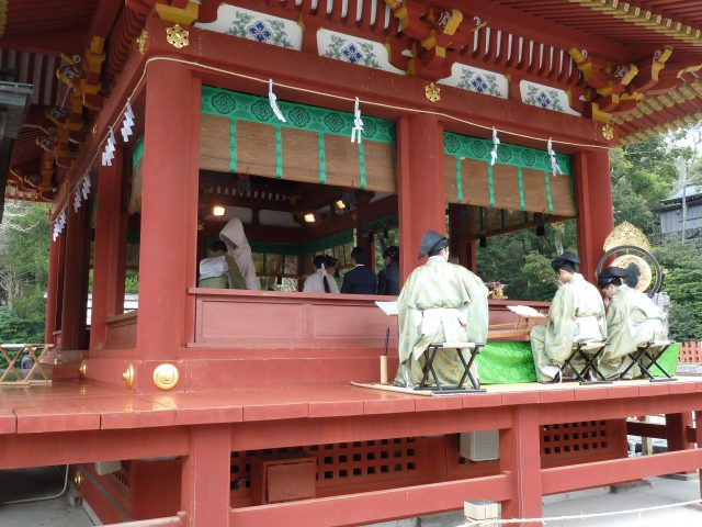 Traditional musicians perform at a wedding ceremony that was taking place in a small pavilion outside the main shrine.
