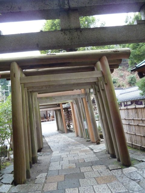 Once through the rock tunnel, visitors pass through a tunnel of torii. Torii mark a passage into sacred space.
