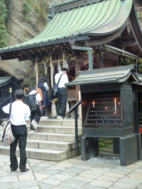 Visitors pray and make offerings before entering a cave to wash their money in the spring (which was too dark for pictures).