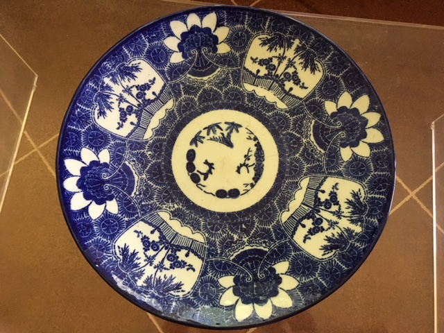 This stenciled plate sits on our coffee table