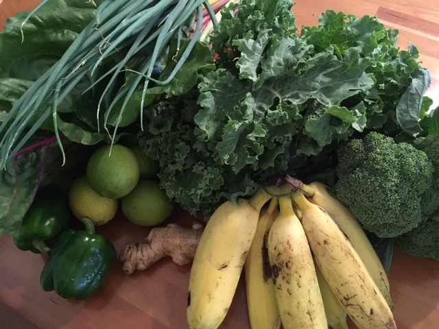 Our farmers' market haul: green peppers, limes, ginger, bananas, Swiss chard, kale, green onions and broccoli. all for just $14!