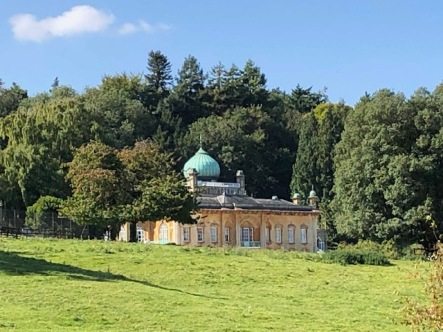 A spectacular view of Sezincote House, with its unique architecture and copper dome.