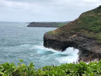 Waves crash against the sanctuary's cliffs