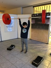 C completes a flawless clean & jerk . . .