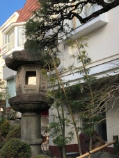 A huge lantern in front of another home