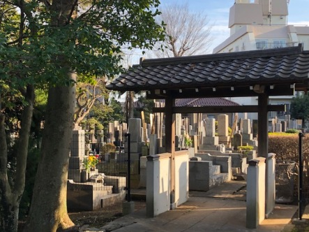 A large cemetery sits in front of the temple, on both sides of the entry path