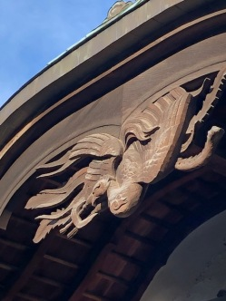 A beautiful carved phoenix over the entrance to the meeting hall