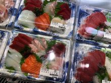 The containers against the wall end with a big selection of fresh sashimi.