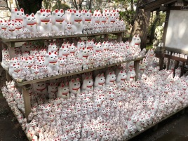 Visitors have purchased and left maneki neko . . .