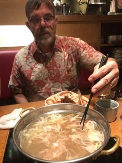 "Brett swishes the beef and cabbage through the broth in the hotpot - ""shabu, shabu"" it says"