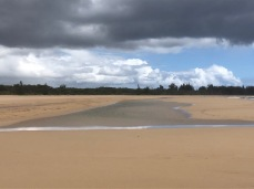 Large pond left on the beach