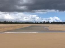 Large pond left on the beach