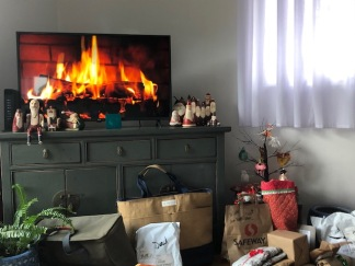 The fire is going, carols are playing . . .